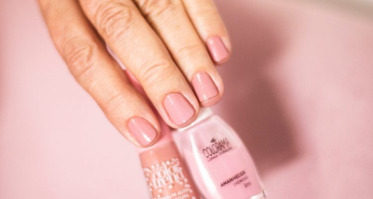 person-holding-nude-color-nail-polish-2281695
